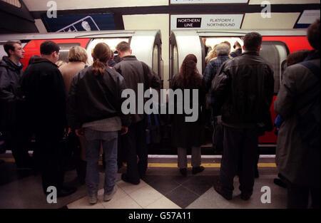 Passengers underground - Stock Photo