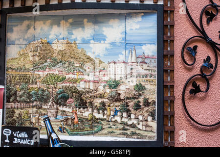 Panel of painted tiles (Azulejo) showing picture of old Sintra ( Cintra Antiga 1829 ), on building wall, Sintra, - Stock Photo