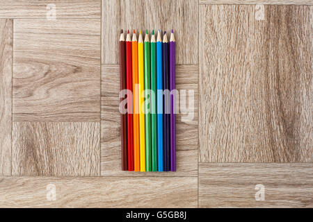 Lots of assorted colors pencils on wooden background, rainbow - Stock Photo
