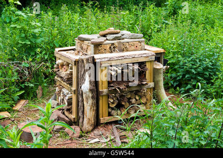 Bug/insect hotel.  Built using natural materials to create a habitat for insects and small animals. - Stock Photo