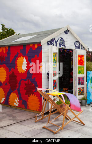 Painted Garden sheds; art & artwork on Beach Hut in Liverpool, Merseyside, UK. Located in Albert dock, 20 wooden - Stock Photo