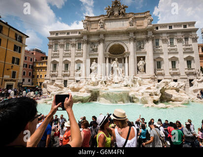 Trevi Fountain or Fontana di Trevia with many tourists in Rome Italy - Stock Photo
