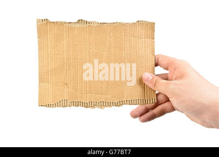 hand holding empty piece of cardboard isolated on white - Stock Photo