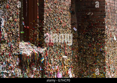 Gum alley (post alley) at the pike place market in Seattle, WA (USA). The walls are covered with multicolored chewing - Stock Photo