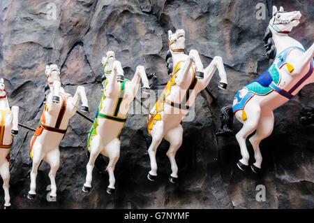Carousel horses on display in Tivoli Garden amusement park and pleasure garden in Copenhagen, Denmark. - Stock Photo