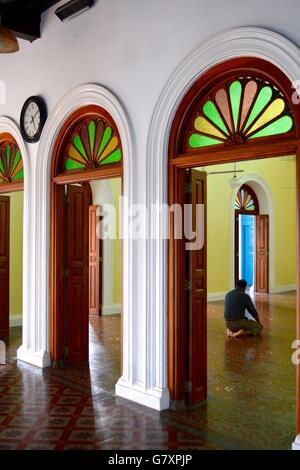 Man praying, interior of Meera mosque in Galle Fort, Sri Lanka - Stock Photo
