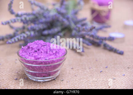 Sea salt on a background of lavender on sacking. Still life. - Stock Photo