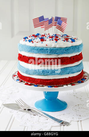 Red velvet and Blueberry cake decorated with American flags - Stock Photo