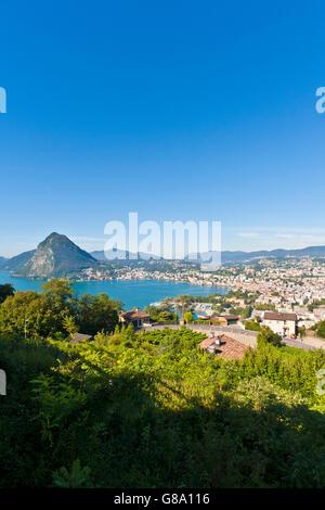 View over Lugano and Lake Lugano, Lago di Lugano, Ticino, Switzerland, Europe - Stock Photo
