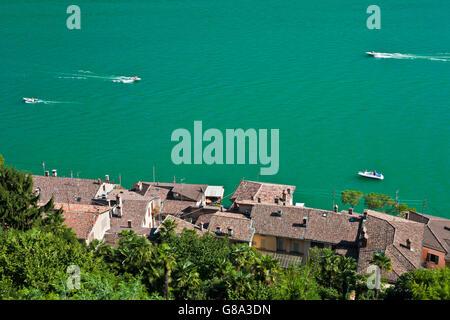 View over Morcote towards boats on Lake Lugano, Lago di Lugano, Ticino, Switzerland, Europe - Stock Photo