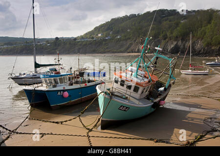 UK, Wales, Ceredigion, New Quay, fishing boats in harbour at low tide - Stock Photo
