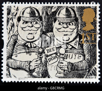 UNITED KINGDOM - CIRCA 1993: A stamp printed in Great Britain shows Tweedledum and Tweedledee (Alice Through the - Stock Photo