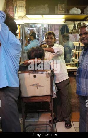 hair cutting barber shop in a slum area of kurla, mumbai, india - Stock Photo