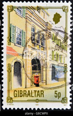 GIBRALTAR - CIRCA 1993: A stamp printed in Gibraltar shows a street of Gibraltar, circa 1993 - Stock Photo
