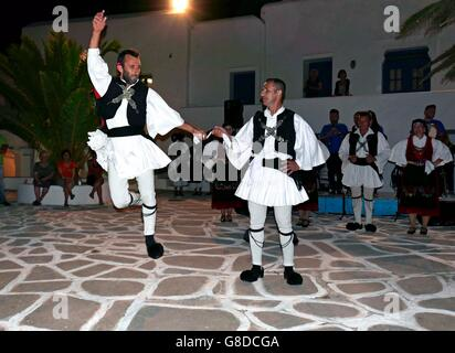 greece cyclades sikinos a group of dancers performing traditional epirus dances in the square - Stock Photo