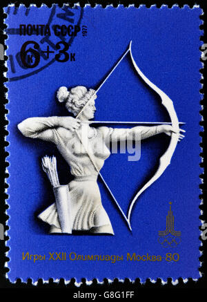 USSR - CIRCA 1977: Stamp, printed in Russia, XXII Olympic games in Moscow in 1980, shows women's archery, circa - Stock Photo