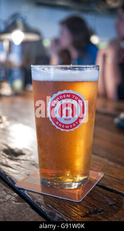 Camden Town Brewery pint of pale ale on a bar in Camden Town North London - Stock Photo