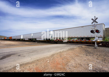 long cargo train moving goods - Stock Photo