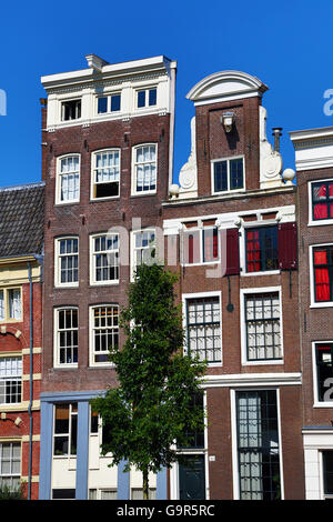 Traditional Dutch houses on the Singel Canal in Amsterdam, Holland - Stock Photo