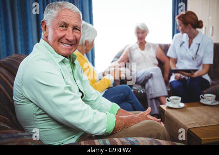 Portrait of a smiling retired man looking at the camera - Stock Photo