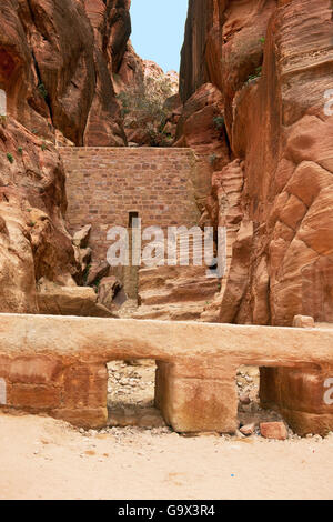 ancient watersupply and dam against flood in canyon, ancient pavestones, Siq of Petra, canyon of Petra Archaeological - Stock Photo