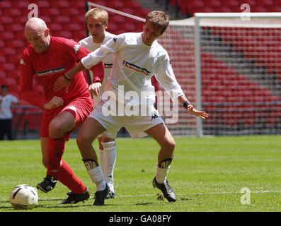Celebrities v Nationwide Customers football match - Stock Photo