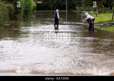 Flood warnings as torrential rain looms - Stock Photo