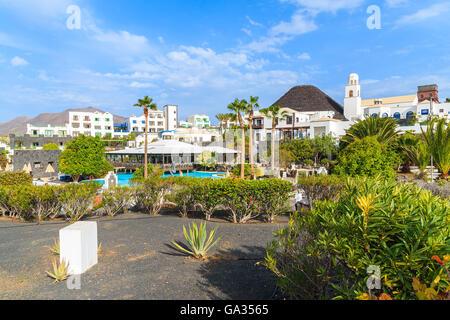 MARINA RUBICON, LANZAROTE ISLAND - JAN 11, 2015: Volcan hotel garden with villas in Rubicon marina, which is a part - Stock Photo