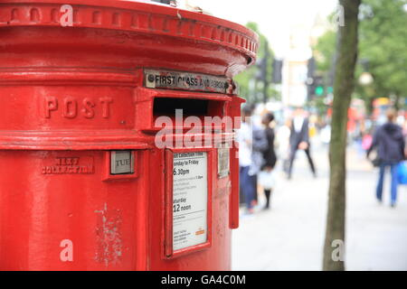 A red letter box on famous Oxford Street, in central London, England, UK - Stock Photo