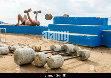 RIO DE JANEIRO - FEBRUARY 12, 2015: Brazilian man exercises at the outdoor workout station at the rocky point of - Stock Photo