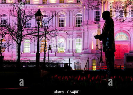 The statue of Jean Drapeau (mayor of Montreal) and the Hotel de Ville at night, Montreal, Quebec, Canada - Stock Photo