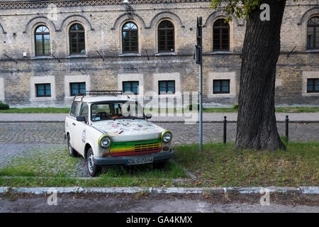 A brightly painted Trabant parked in the old suburb of Gdansk, Poland. This once popular and iconic car was very - Stock Photo