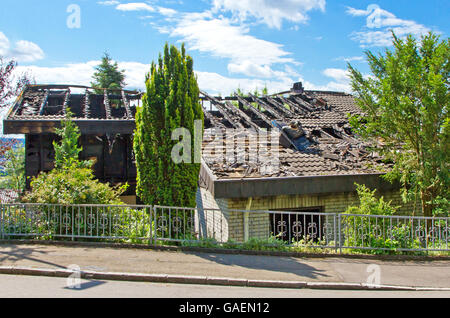 Burned house after a lightning strike - Stock Photo