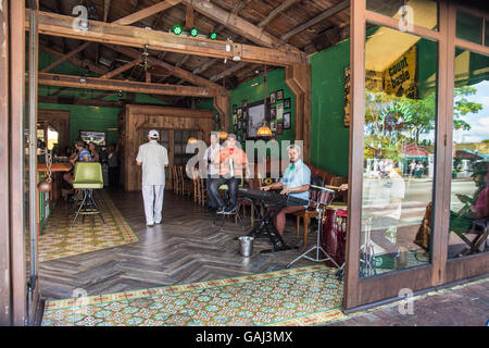 Open bar sidewalk scene in the Little Havana district of Miami Florida with Cuban musicians playing music - Stock Photo