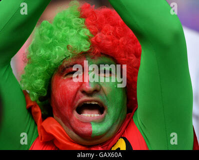 Lyon, France. 6th July, 2016. A fan of Portugal cheers before the Euro 2016 semifinal match between Portugal and - Stock Photo