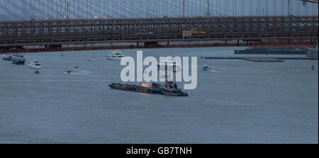 New York, NY USA - July 4, 2016: View of 40th annual Macys 4th of July fireworks barge preparation on East River - Stock Photo