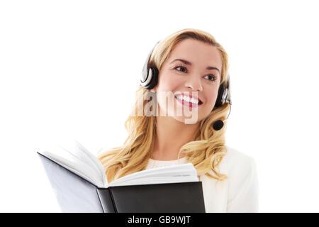 Closeup portrait of female customer service representative wearing headset. - Stock Photo