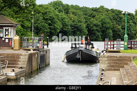 A Barge waiting to enter Boveney Lock on the River Thames in England - Stock Photo