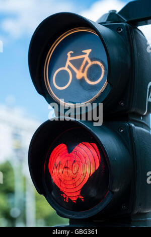 Detail of red stop light at  traffic lights for cyclists with red love heart in Berlin Germany - Stock Photo