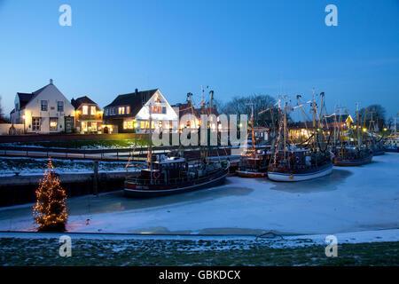 Fishing boats in the harbour, Greetsiel, Krummhoern, East Frisia, Lower Saxony, North Sea - Stock Photo