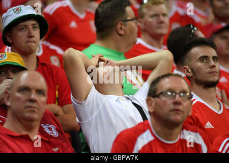 Lyon, France. 6th July, 2016. Disappointed Welsh fans react to Ronaldo's second goal in the secon half during the - Stock Photo