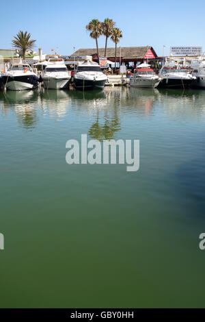 Yachts moored in Mediterranean style marina of Cabopino, Andalusia, Spain. - Stock Photo