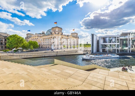 Panoramic view of Berlin government district with excursion boat on Spree river passing famous Reichstag building, - Stock Photo