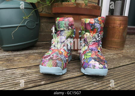 Recycled walking boots. - Stock Photo