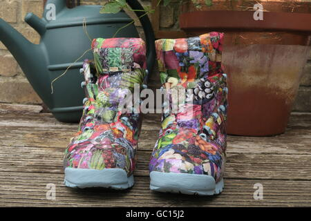Re-imagined walking boots, decorated using decoupage. - Stock Photo