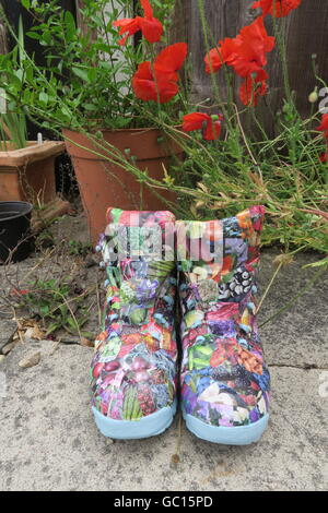 Decorated planter decoupaged boot - Stock Photo