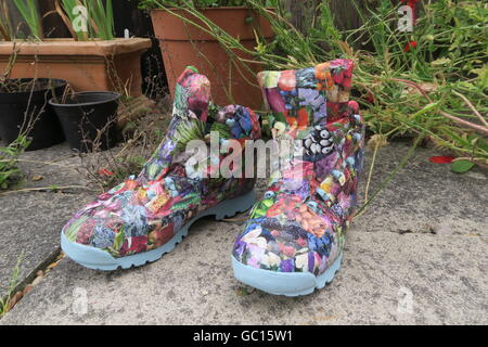Re-purposed walking boots - Stock Photo
