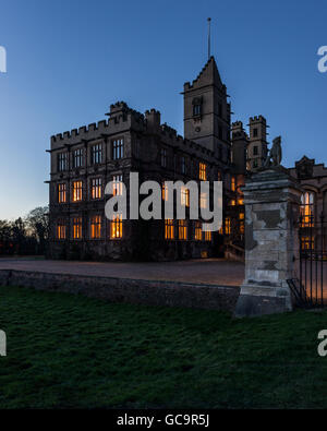 Night time view of exterior facade building,  architecture Grade I Listed building Victorian Gothic stately home - Stock Photo
