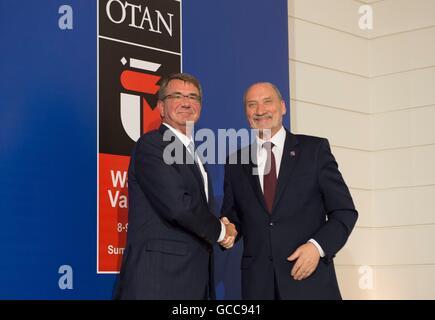 U.S Secretary of Defense Ash Carter shakes hands with Polish Minister of Defense Antoni Macierewicz during the NATO - Stock Photo