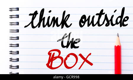 Think Outside The Box written on notebook page with red pencil on the right - Stock Photo